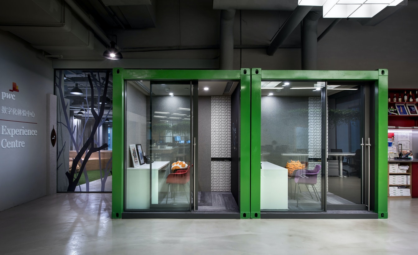 Enclosed meeting areas use glass to enhance transparency