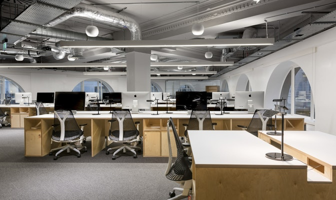 Custom made desks in Wipro's office space