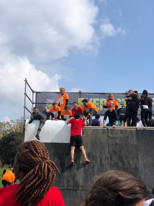 Team-building and supporting charity at Tough Mudder section