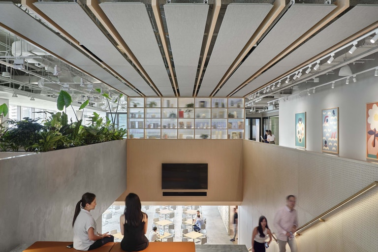 Workplace community – Integrated stair, theatre seating, cafe and connective 'jungle' garden areas offer a wide variety of environments for this connected workplace community designed to meet WELL, LEED, and RESET standards – Zendesk Singapore.