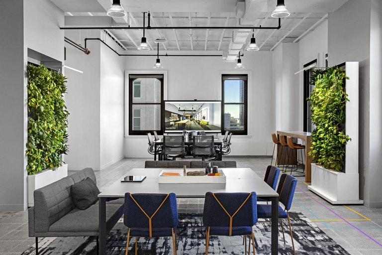 Versatility | Biophilia – Movable biophilic walls on wheels empower users to reconfigure the space to meet their needs in the M Moser New York workplace designed to WELL Platinum, LEED and RESET Certification standards.