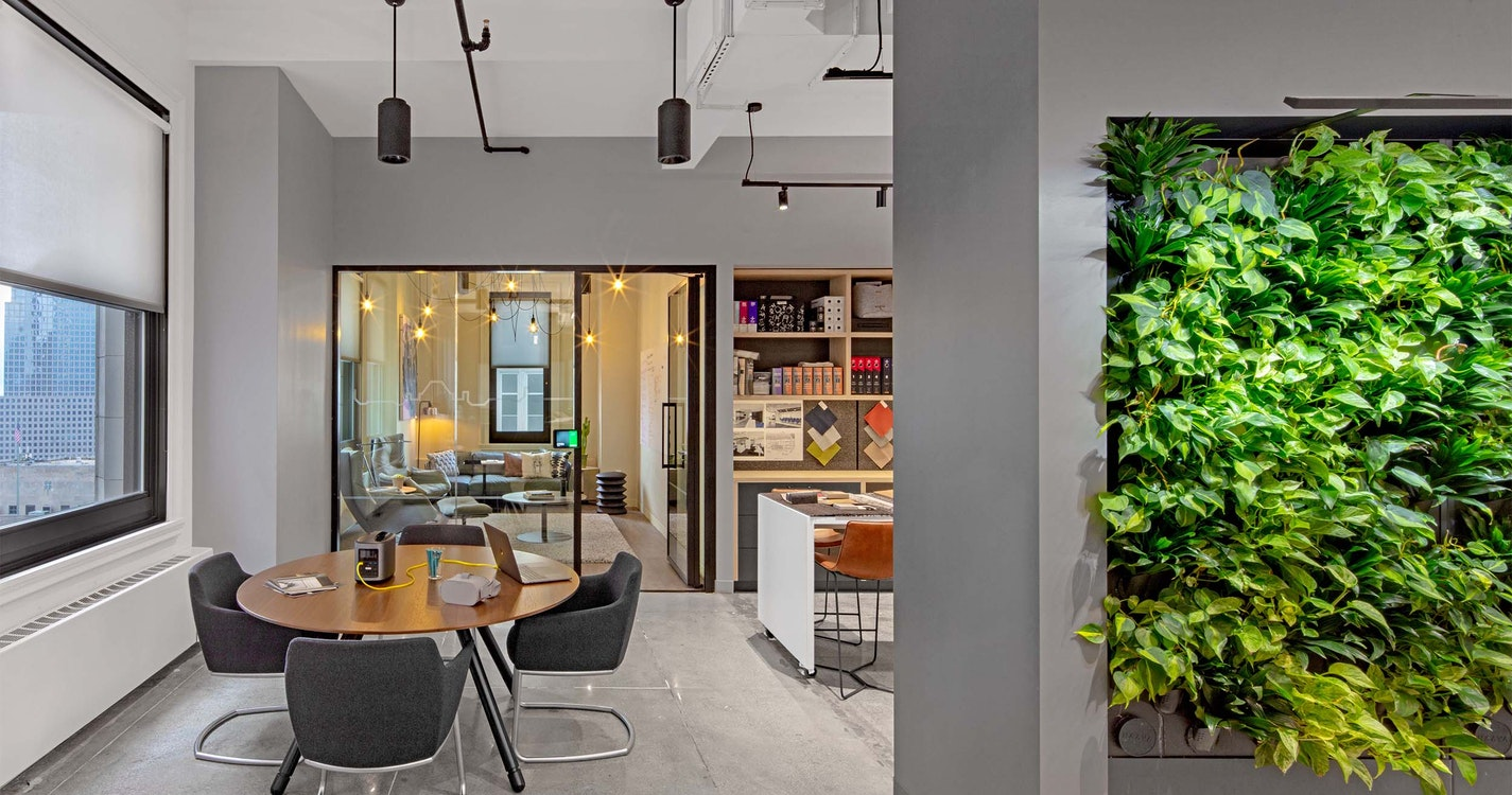 Collaboration space in front of focus room with green living wall