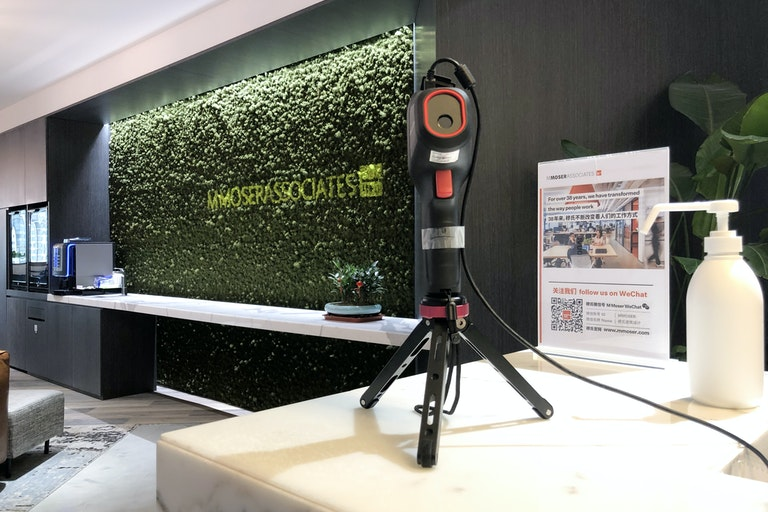 Setting up infrared thermometers to screen incoming staff and visitors at M Moser, Shanghai