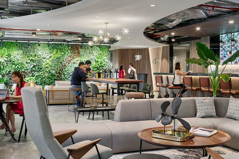 Trend Micro's combination of its biophilic wall and sound creates a soothing arrival experience