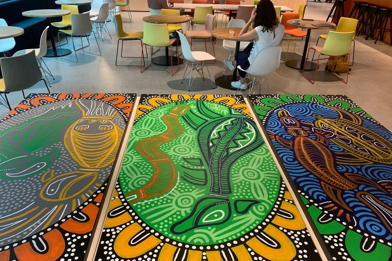 Custom canvas artwork created by Aboriginal artist Chaboo, illustrating the Nutanix customer journey and how it is represented through our water, land and sky.